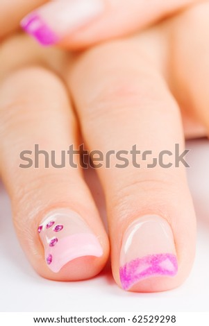 coloured pink female fingernails on white ground
