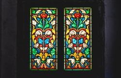coloured stained glass window colored in a dark background church