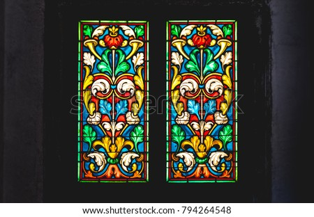 coloured stained glass window colored in a dark background church #794264548