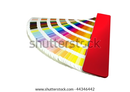 coloured swatches book open showing an array of rainbow colours - stock photo