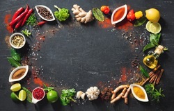 Colourful background of various herbs and spices in bowls for cooking with copy space for your text