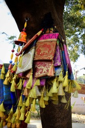 Colourful bags or purses are being sold in the market of Varanasi. Beautiful handicrafts items in the souvenir market in India. Beautiful Indian traditional bags for sale in Sarnath, Varanasi