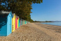 Colourful beach huts Llanbedrog beach Llyn peninsula Wales between Pwllheli and Abersoch