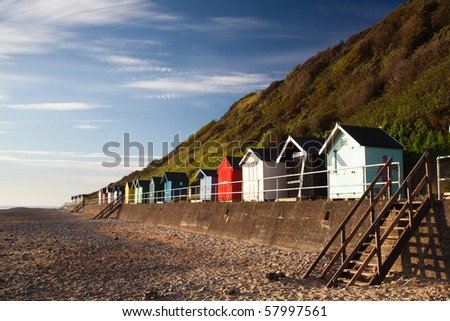 Colourful beach huts with blue sky