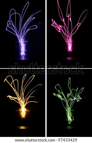 Colourful, beautiful light trails exploding out of a glass jar. Creativity and invention concept. Light painting.