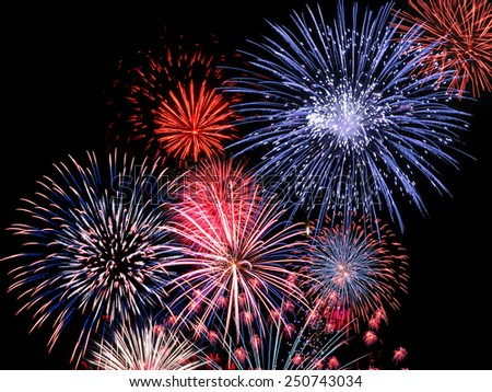 Colourful blue, red and pink fireworks display for celebrations #250743034