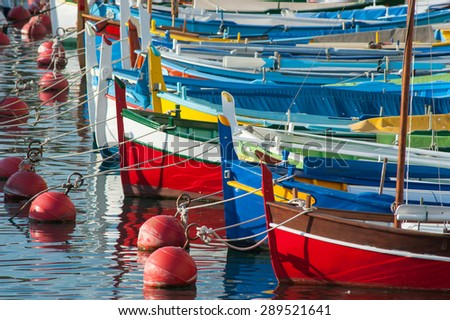 colourful boats docked in the port of nice in the south of France #289521641