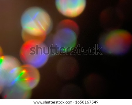 Photo of  Colourful bokeh on black background