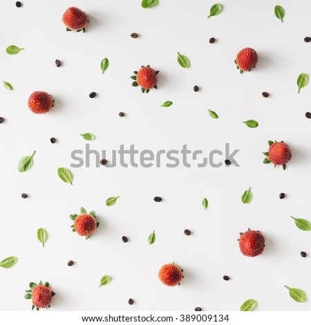 Colourful bright pattern made of strawberries, coffee beans and leaves.