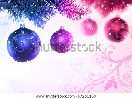 Colourful christmas baubles hanging from a tree.