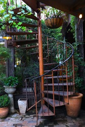 Colourful circular iron steps surrounded by green plants and flowers in a Sydney NSW Australia Garden