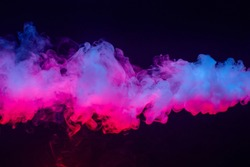 Colourful cloud of vapor. dark black background. nobody