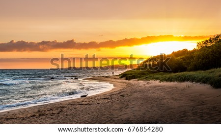 Colourful coastline sunset with beautiful beach and ocean #676854280