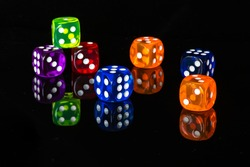 Colourful dices with reflection on black background