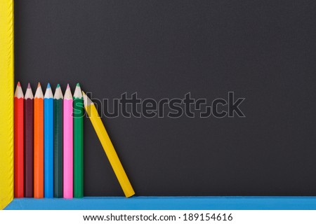 Colourful Drawing Pencils in Front of a Blackboard.Copy Space