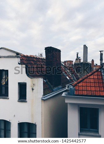 Colourful exteriors with tile roofs. Old town houses in Brussels, Belgium, Europe #1425442577