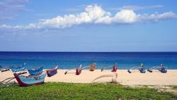 Colourful fishing boats on Dutch Bay beach in Trincomalee, Sri Lanka