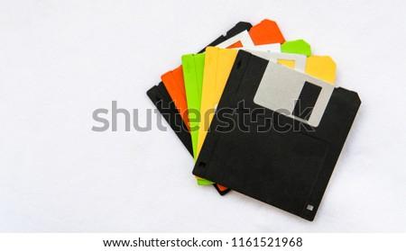 Colourful floppy disks on white background.