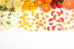 Colourful fruit balloon in rainbow colours top view on the white background: strawberries, blueberries, mango, orange, kiwis