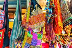 Colourful handmade  fashion bags at chatuchak weekend market in Bangkok Thailand