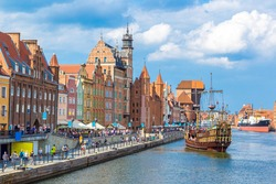 Colourful historic houses near Motlawa river in port of Gdansk, Poland.