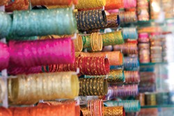 Colourful Indian bangles or wrist bracelets on display at a shop in Laad Bazaar. Hyderabad, India