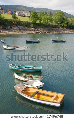 colourful little boats in the bay in Ireland
