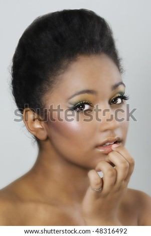 Colourful makeup on dark skinned beauty