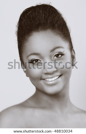 Colourful makeup on dark skinned beauty - stock photo