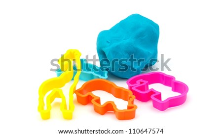 Colourful molding dough and cutters for children isolated on white background - stock photo