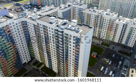 Colourful multi-storey complex of new buildings. Motion. Top view of beautiful multicolored design of facade of residential high rise Сток-фото ©