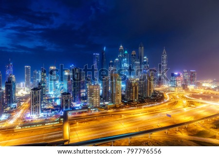 Colourful nightime skyline of a big modern city. Dubai Marina, United Arab Emirates with highways and skyscrapers. #797796556