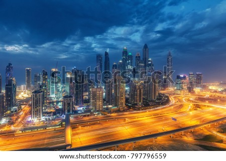 Colourful nightime skyline of a big modern city. Dubai Marina, United Arab Emirates with highways and skyscrapers. #797796559