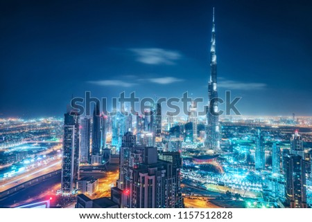 Colourful nighttime skyline of a big modern city. Dubai, United Arab Emirates. Aerial view on highways and skyscrapers. #1157512828