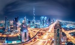 Colourful nighttime skyline of a big modern city. Dubai, United Arab Emirates. Travel background.