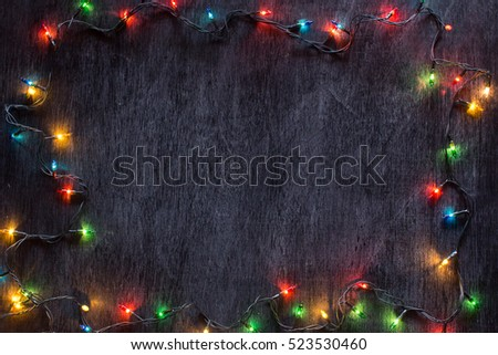 Colourful of decorative light on black paint wood with white chalk effect, for centre text.