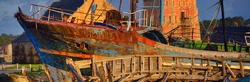Colourful old traditional wooden fishing boats after shipwreck. Sunset. Camaret sur Mer, Brittany, France. Transportation, nautical vessel, cruise, tourism, landmarks, history. Panoramic view