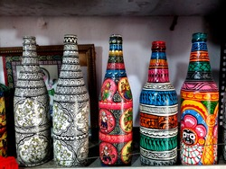Colourful paintings on the glass bottles made by the artisans Of Raghurajpur village, Orissa, India.