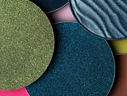 Colourful palette of eye makeup. Closeup of lilac, green, brown and blue eyeshadows. Cosmetic products background in trendy color scheme.