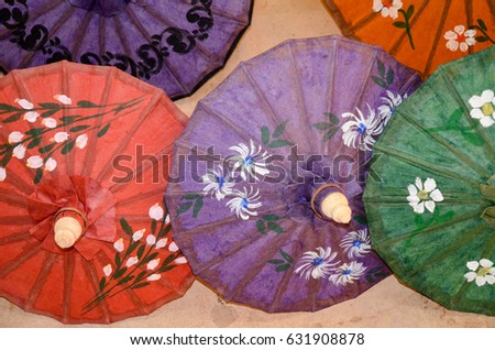 Colourful paper umbrellas for sale at a traditional paper making workshop, near Heho #631908878