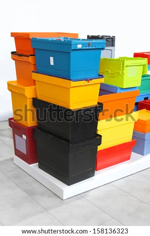 Colourful plastic crates and boxes for delivery shipping