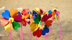 colourful plastic toy fans in beach shore