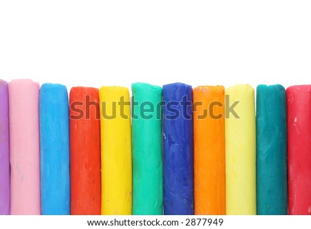 Colourful plasticine pieces isolated on white