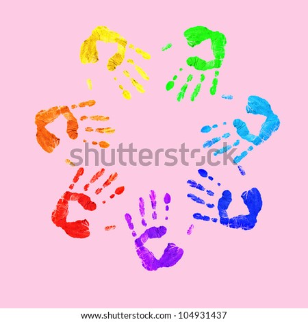 Colourful prints of human hands on white background