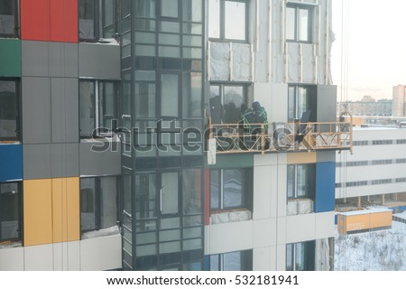 Colourful residental building under construction. Stained glass facades, ventilated facade system, mineral wool insulation #532181941