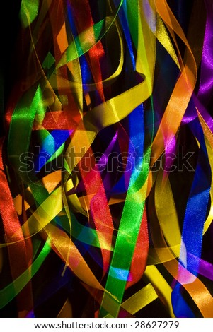 colourful ribbons lit against a dark background