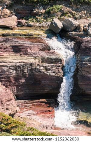 Rocks in a river/ River Rocks/ Colorful rocks in a river in