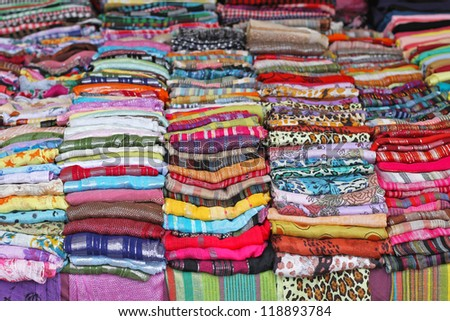 Colourful scarves and shawls at market stall