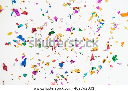 colourful sparlking confetti on white background #402762001