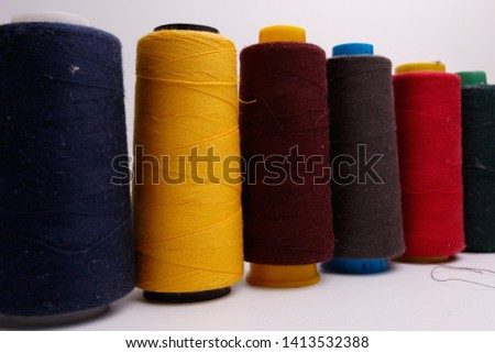 Colourful spools of thread on white background #1413532388